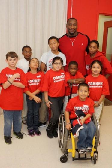 Houston Texans Antonio Smith with the kids