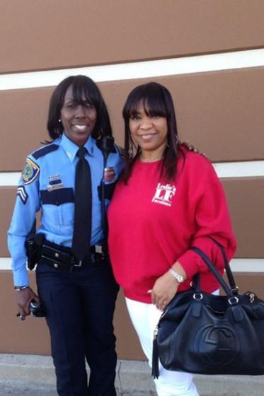 HPD Officer Mary Young and Leslie Larose-Nash, owner of Leslie's Furniture