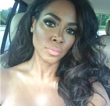 "[Watch]: Kenya Moore's trigger finger puts a ""Cap in that A**"" on social media"