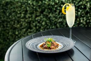 Cafe Azur Duck Confit Taco + French 75